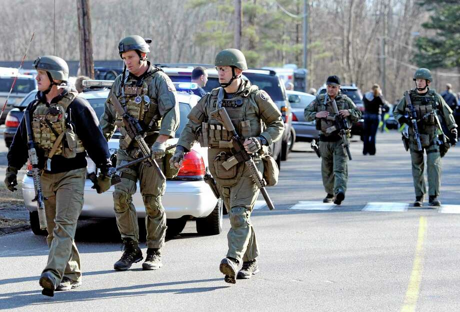 State Police on the scene following a shooting at the Sandy Hook Elementary School in Newtown Dec. 14, 2012. Photo: Jessica Hill — The Associated Press  / FR125654 AP