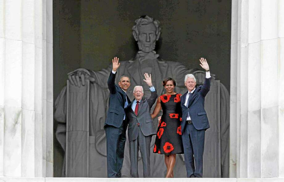 President Barack Obama, first lady Michelle Obama, former President Jimmy Carter and former President Bill Clinton wave as they leave 50th Anniversary of the March on Washington where Martin Luther King Jr., spoke, Wednesday, Aug. 28, 2013, at  the Lincoln Memorial in Washington. (AP Photo/Charles Dharapak) Photo: AP / AP