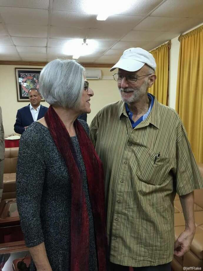 This handout photo from the Twitter account of Sen. Jeff Flake, R-Ariz. shows Alan Gross with his wife Judy before leaving Cuba, Wednesday, Dec. 17, 2014. The US and Cuba have agreed to re-establish diplomatic relations and open economic and travel ties, marking a historic shift in U.S. policy toward the communist island after a half-century of enmity dating back to the Cold War, American officials said Wednesday. The announcement came amid a series of sudden confidence-building measures between the longtime foes, including the release of American prisoner Alan Gross, as well as a swap for a U.S. intelligence asset held in Cuba and the freeing of three Cubans jailed in the U.S. (AP Photo/Jeff Flake) Photo: AP / Twitter account of Sen. Jeff Flake, R-Ariz.