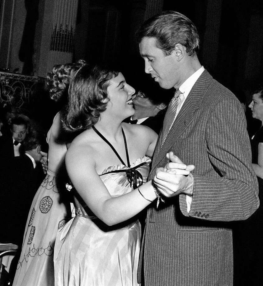 """FILE - In this April 1, 1943 file photo, movie star Jimmy Stewart dances with Mary Rodgers at the """"Oklahoma!"""" fifth birthday party at the Plaza in New York. Rodgers, the daughter of Broadway icon Richard Rodgers, who found her own fame as composer of the 1959 musical """"Once Upon a Mattress"""" and as the author of the book """"Freaky Friday,"""" has died. She was 83. (AP Photo/EF, file) Photo: AP / AP"""