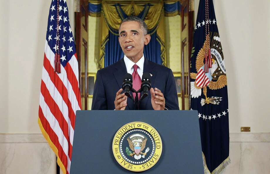 """President Barack Obama addresses the nation from the Cross Hall in the White House in Washington in September saying he had authorized U.S. airstrikes inside Syria for the first time, along with expanded strikes in Iraq, as part of """"a steady, relentless effort"""" to root out Islamic State extremists. Photo: File Photo  / Pool AFP"""