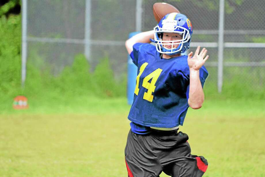 John Lippincott, a senior, is going into his third season as the Yellowjackets quarterback. Last season he led them to a 7-3 record while throwing 20 touchdowns and for seven touchdowns on the ground. Photo: Pete Paguaga—Register Citizen