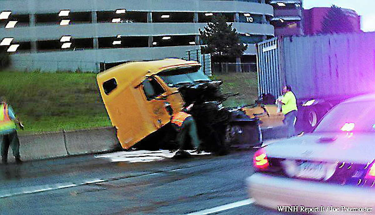 A jackknifed tractor trailer accident caused major delays on I-84 eastbound in Waterbury Tuesday morning.(Courtesy of WTNH Report It / Joe Paternoster)