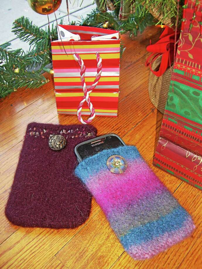 Photo courtesy of Ginger Balch Knitted cell phone cases make an easy, charming gift for anyone on your holiday list. Photo: Journal Register Co.
