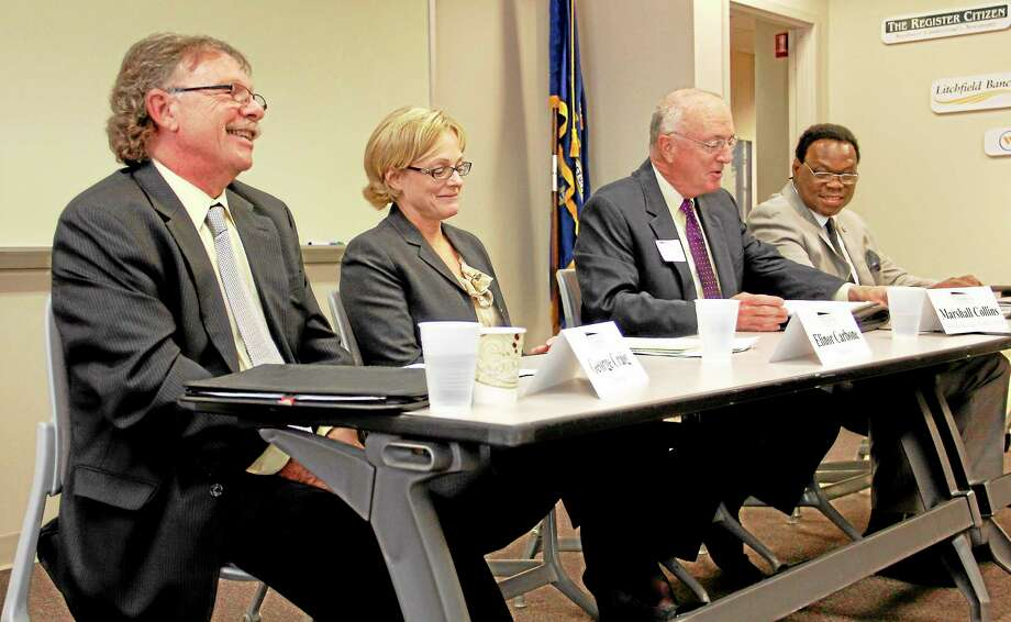 From left: Democrat George Craig, Republican Elinor Carbone, Marshall Collins and unaffiliated candidate Jacque Williams during the mayoral forum hosted by the Northwest Chamber of Commerce on Thursday, Oct. 17, inside the chamber's office in Torrington. The forum gave business leaders and community members an opportunity to ask the candidates questions. Register Citizen Esteban L. Hernandez Photo: Journal Register Co.