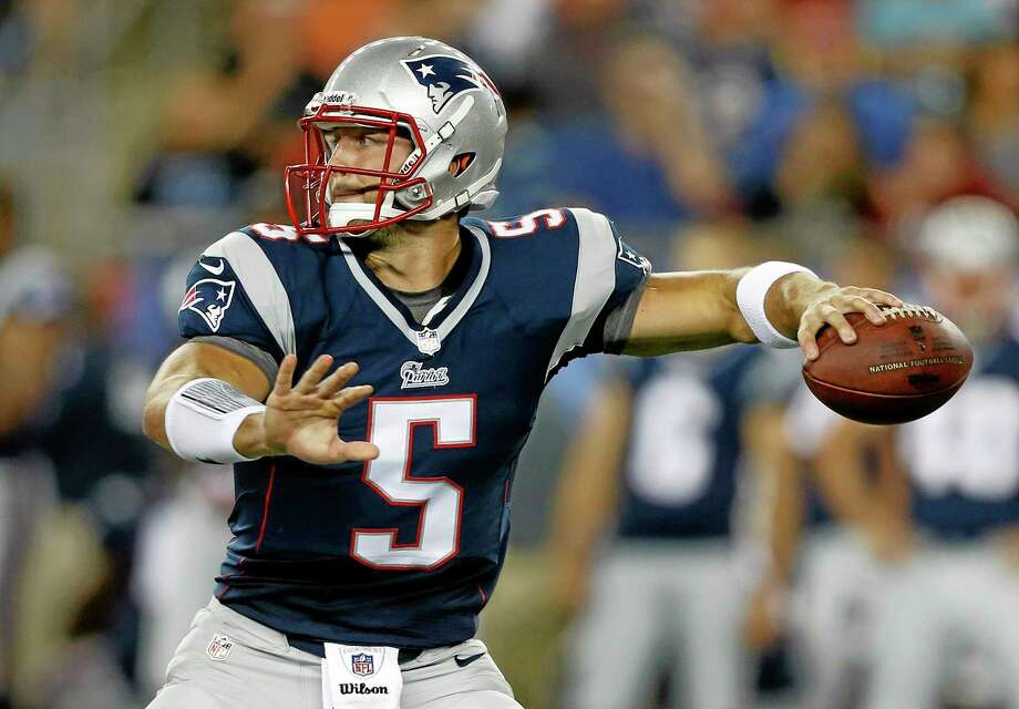 In this Aug. 16, 2013, file photo, New England Patriots quarterback Tim Tebow throws a pass against the Tampa Bay Buccaneers during the third quarter of an NFL preseason football game in Foxborough, Mass. The NFL never really shuts down. It kept rolling long after the lights came back on after a 37-minute delay at the Super Bowl, right into a new season that will kick off in less than two weeks and end with an outdoor Super Bowl in New Jersey. Photo: MICHAEL DWYER — THE ASSOCIATED PRESS  / AP