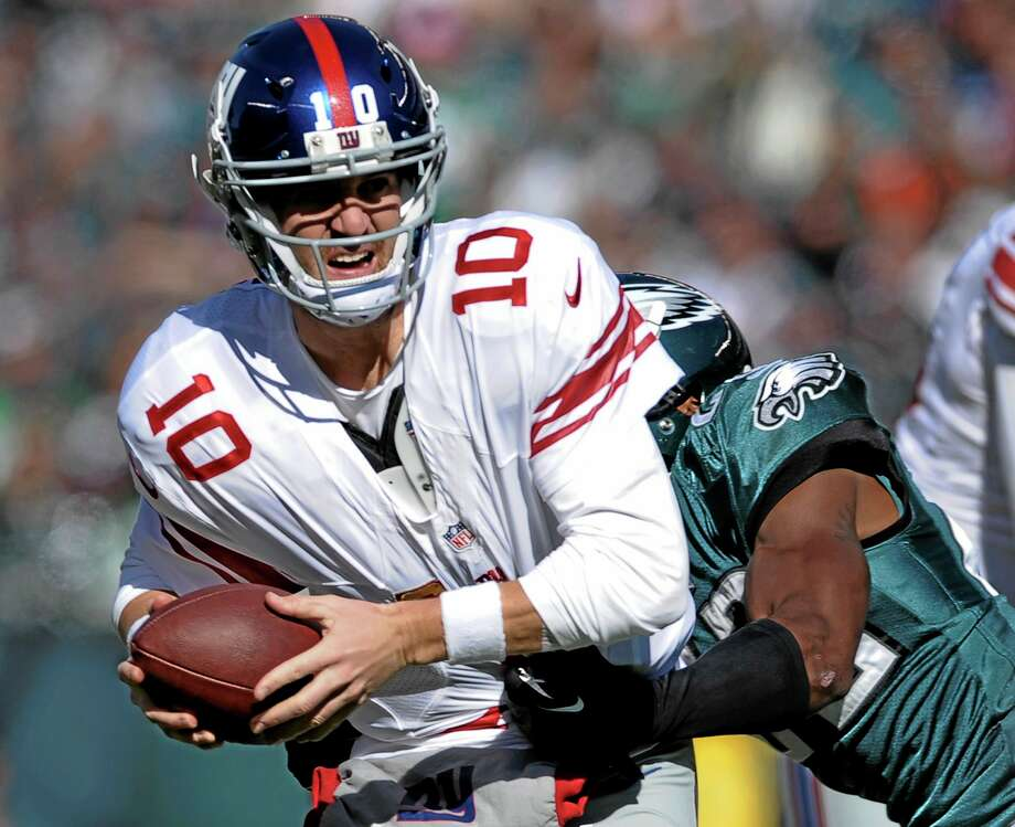 Giants quarterback Eli Manning has been one of the tricks this fantasy football season. Photo: Michael Perez — The Assocaited Press  / FR168006 AP