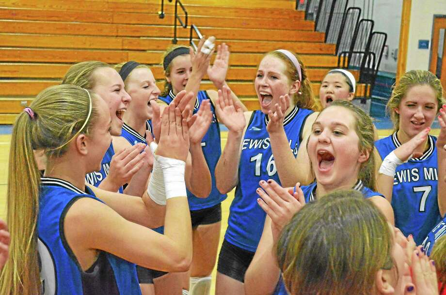 Lewis Mills volleyball team celebrates after winning the Berkshire League championship Friday night after beating Terryville. Photo: John Berry — Register Citizen