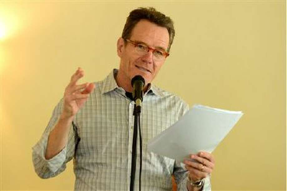 """Bryan Cranston reads from """"The Magiker,"""" by Charles Dennis, in The Caribou Room at Sportsmen's Lodge on Tuesday, Oct. 22, 2013, in Studio City, Calif. Photo: Jordan Strauss/Invision/AP / Invision"""