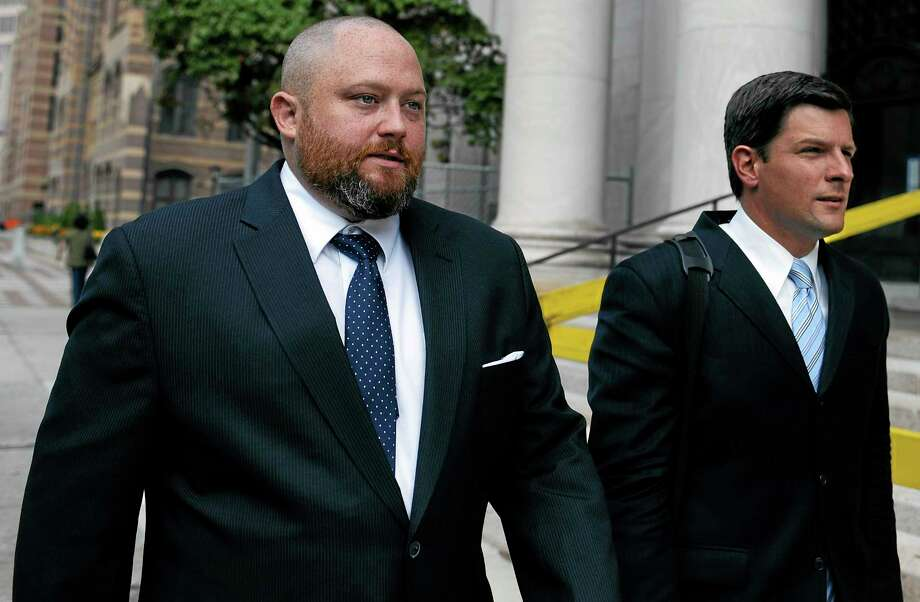 Robert Braddock Jr., former aide to ex-Connecticut House Speaker Christopher Donovan, left, arrives with his attorney Frank Riccio II, at Federal Court to be sentenced in New Haven, Conn., Tuesday, Aug. 27, 2013. Braddock was found guilty in May of campaign finance and conspiracy charges. Photo: Jessica Hill — The Associated Press  / FR125654 AP