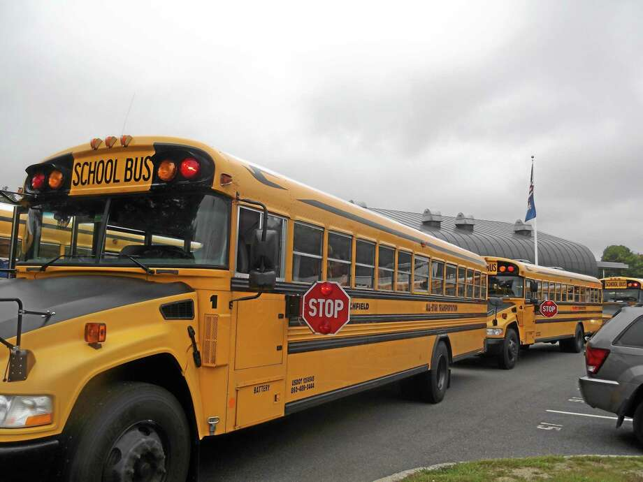 Buses line up outside Litchfield High School to bring students home from their first day of school in 2012. Photo: Register Citizen File Photo