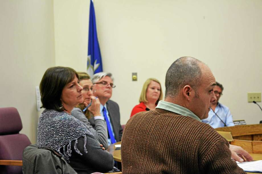 Ryan Flynn - Register Citizen ¬ The board adopted the total budget number Tuesday night, though the line items themselves may be given a closer look. Photo: Journal Register Co.