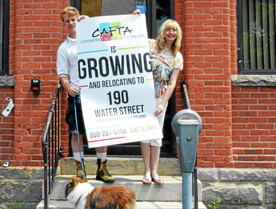 Theresa and John Sullivan, artists and founders of CAFTA in front of their new location at 190 Water St. Wednesday, the site of the former Register Citizen offices. Photo: Jenny Golfin — The Register Citizen