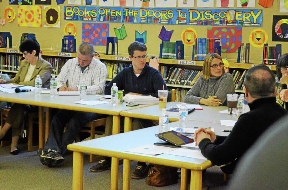 Torrington Superintendent Cheryl Kloczko, Board of Education Chair Kenneth Traub, board member Christopher Rovero, and board vice chair Fiona Cappabianca seen during a public hearing on Kloczko's proposed budget for the district Monday evening. Photo: Isaac Avilucea — Register Citizen