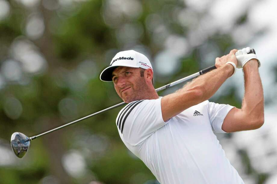 Dustin Johnson will be making his first appearance at the Travelers Championship since 2009. Photo: Marco Garcia — The Associated Press  / FR132415 AP