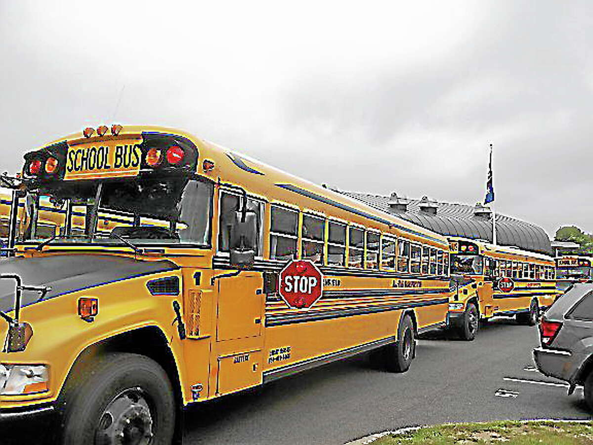 File photo - Register Citizen ¬ Buses line up on the first day of the school year in Litchfield.