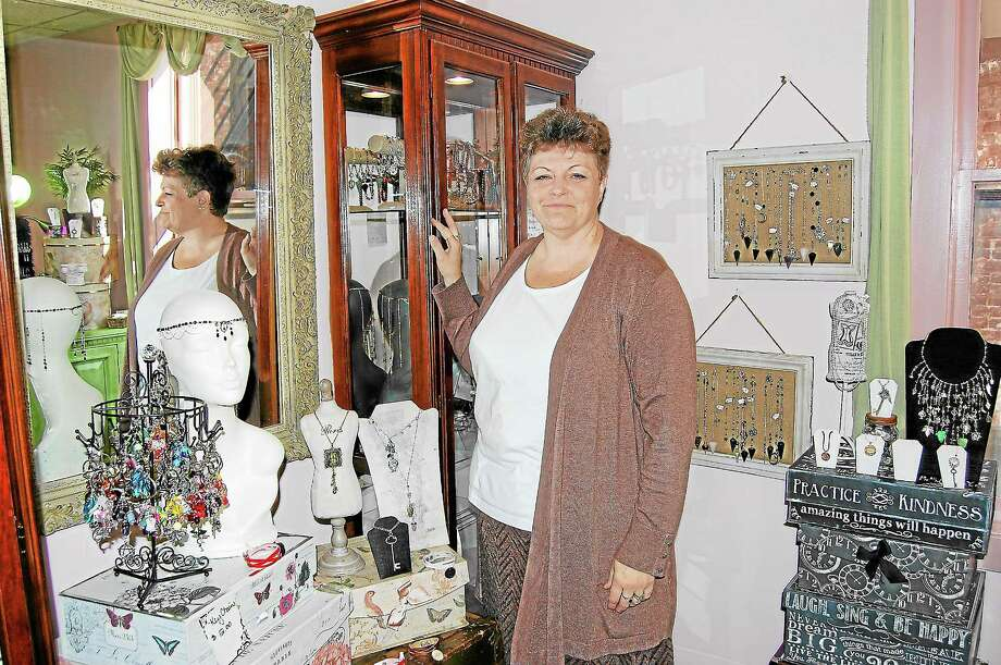 Dawn Hill of Dawn Hill Designs with a variety of the jewelry she creates in her second floor studio at Morrison's Artist Collective. Photo: Jenny Golfin—Register Citizen