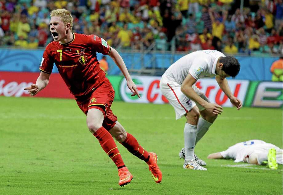 Belgium's Kevin De Bruyne celebrates after scoring the opening goal during the World Cup round of 16 soccer match between Belgium and the USA at the Arena Fonte Nova in Salvador, Brazil, Tuesday, July 1, 2014. (AP Photo/Matt Dunham) Photo: AP / AP