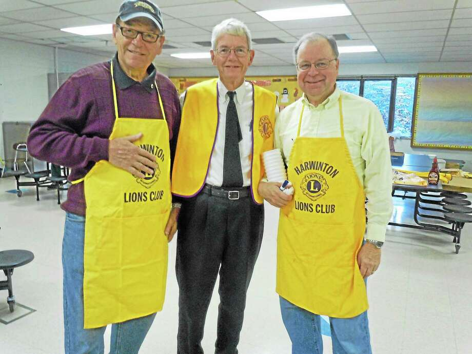 Left to right are Harwinton Lions Brad Cagenello, Frank McElwee, and Ed Zielinski at last year's Scholarship Pancake Breakfast. Photo: Register Citizen File Photo