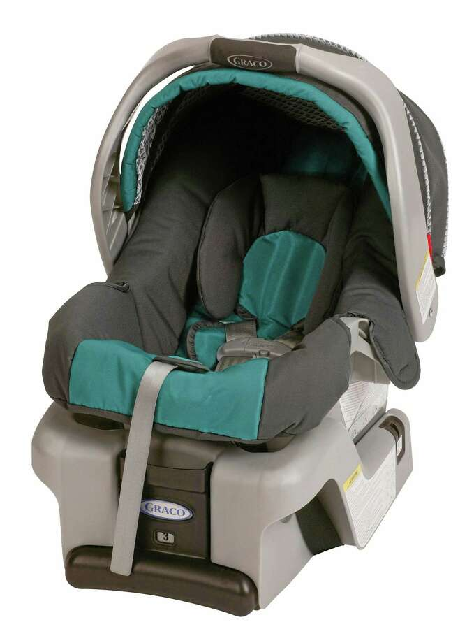 This undated photo provided by Graco Childrenís Products shows a SnugRide Classic Connect infant car seat. Graco Children's Products is recalling 1.9 million infant car seats, bowing to demands from U.S. safety regulators in what is now the largest seat recall in American history. (AP Photo/Graco Childrenís Products) Photo: AP / Graco Children's Products