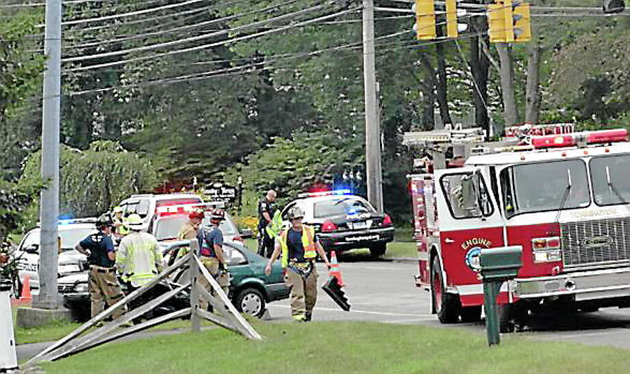 Firefighters and police at the scene of a two-car crash on New Harwinton Road on Monday. Photo: Contributed Photo—Monique Pace