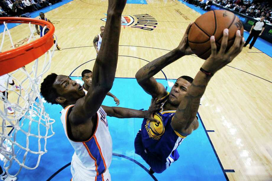 Former Golden State Warriors forward Jeremy Tyler, here trying to shoot over Oklahoma City center Hasheem Thabeet, has signed with the New York Knicks. Photo: Sue Ogrocki — The Associated Press  / AP