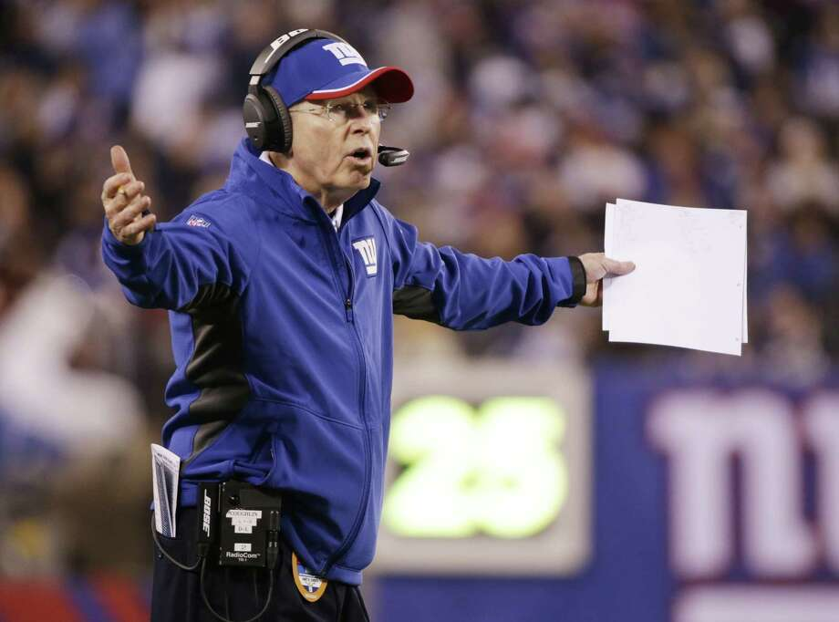 Winning two games in a row late in the season has not shed any light on whether Tom Coughlin will be returning as coach of the New York Giants. The 68-year-old Coughlin said Monday he has not had talks with management about his future, saying it will be dealt with at the appropriate time. Photo: Julio Cortez — The Associated Press File Photo  / AP