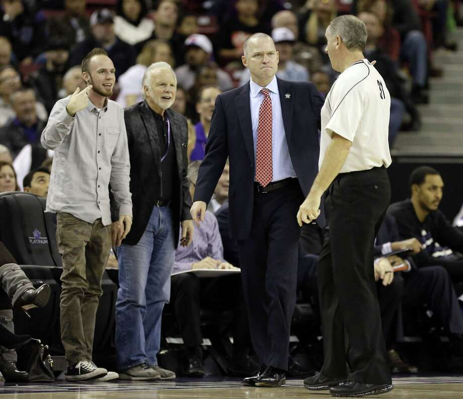 Official Scott Wall, right, explains a foul he called against Sacramento to Kings head coach Michael Malone, second from right, during the fourth quarter of a Dec. 2 game against the Toronto Raptors in Sacramento, Calif. Photo: Rich Pedroncelli — The Associated Press  / AP