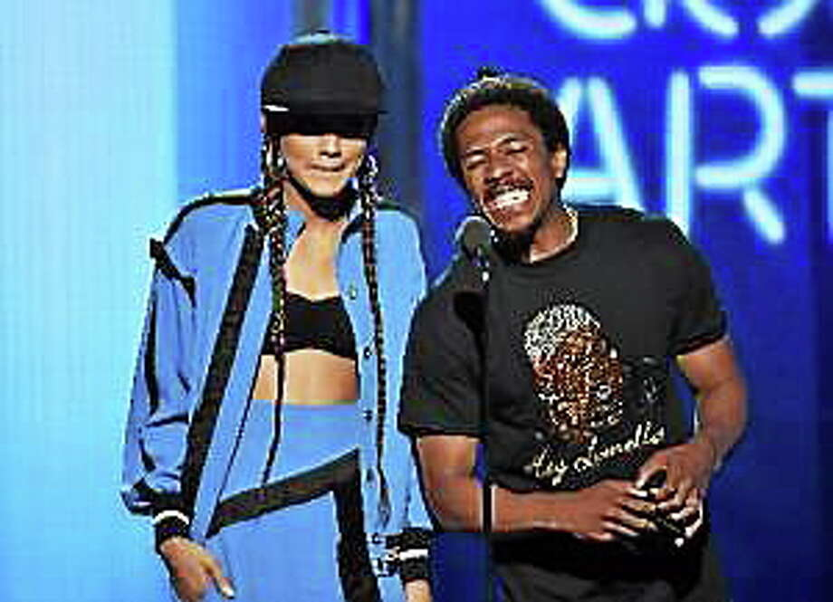 Actress Zendaya and TV personality Nick Cannon speak onstage during the BET Awards '14 at Nokia Theatre on June 29, 2014 in Los Angeles, California. Photo: (Kevin Winter — Getty Images)