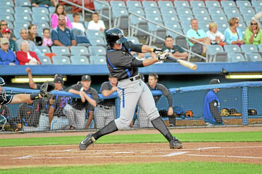 Conor Bierfeldt swings during a game on August 16 against the Connecticut Tigers. Photo: Pete Paguaga—Register Citizen
