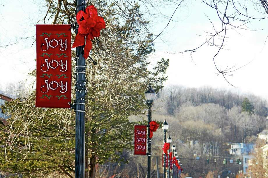 Holiday decorations adorn a light post on Main Street in Winsted on Monday. The decorations were placed there by local volunteers who wanted the town to have some holiday decor. Photo: Esteban L. Hernandez — The Register Citizen