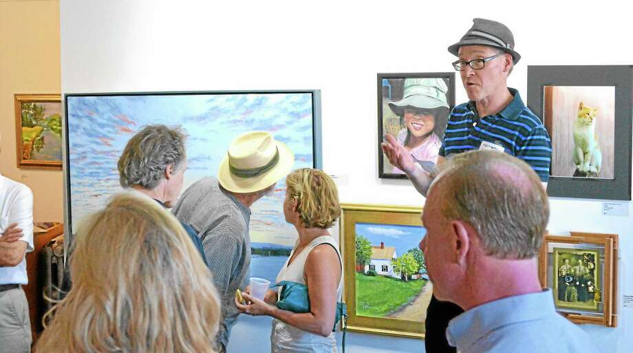 Michael Yurgeles, Executive Director of Artwell, talks to the crowd at the Torrington gallery's Show for a Show opening night, Saturday. Photo: John Berry - Register Citizen