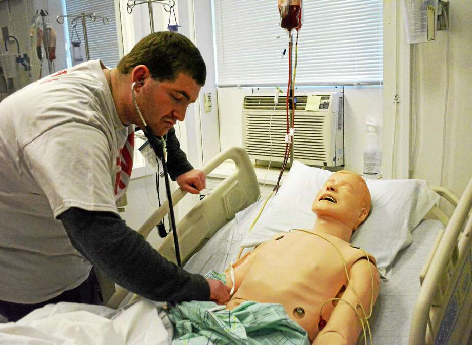 Baras Lebovitz, a student from Woodhall School, how a high-tech mannequin simulates a real patient at Charlotte Hungerford Hospital in Torrington. Photo: Kaitlin McCallum — THe Register Citizen