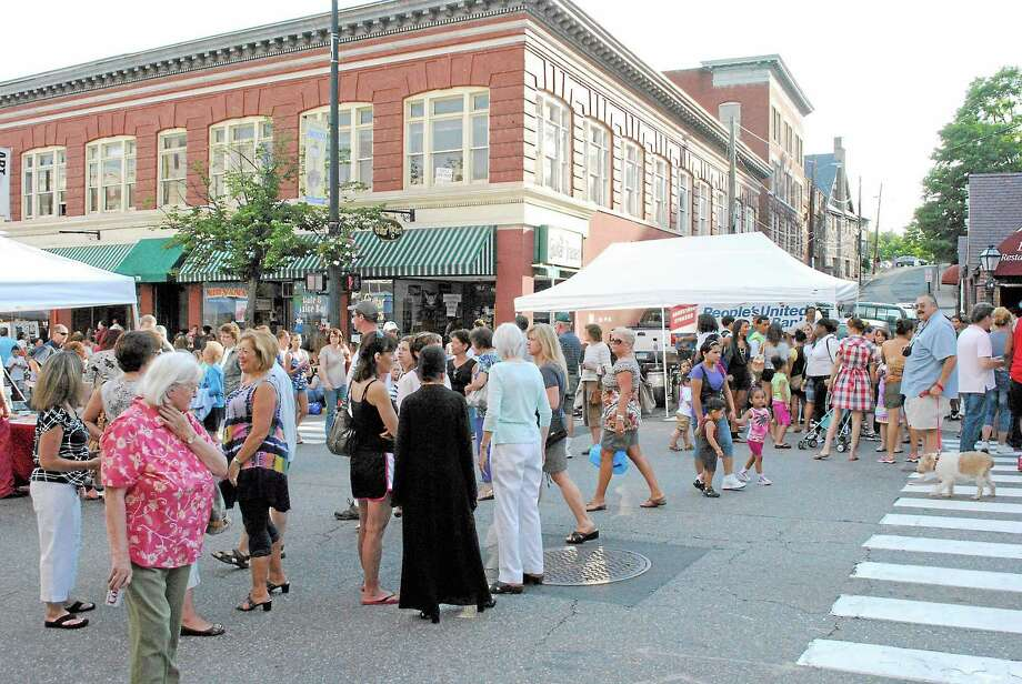 Crowds of people enjoy a night out at Main Street Marketplace in Torrington. Photo: Register Citizen Fil Photo