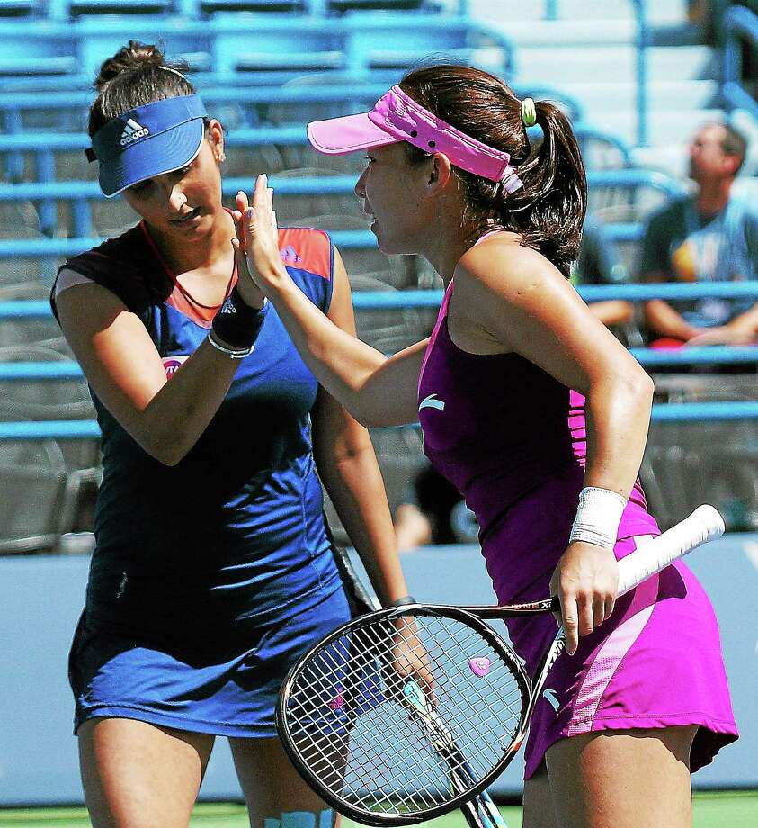 (Peter Casolino — New Haven Register) Sania Mirza, left, and Jie Zheng react as they beat Anabel Medina Garrigues and Katarina Srebotnik during the doubles finals. Photo: Journal Register Co.