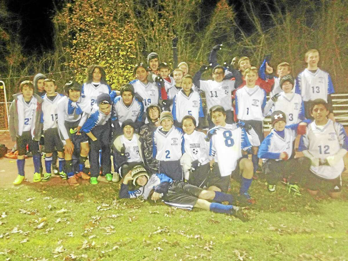 The Torrington Middle School boys soccer team claimed their title as champions of the Naugatuck Valley League in November 2013.