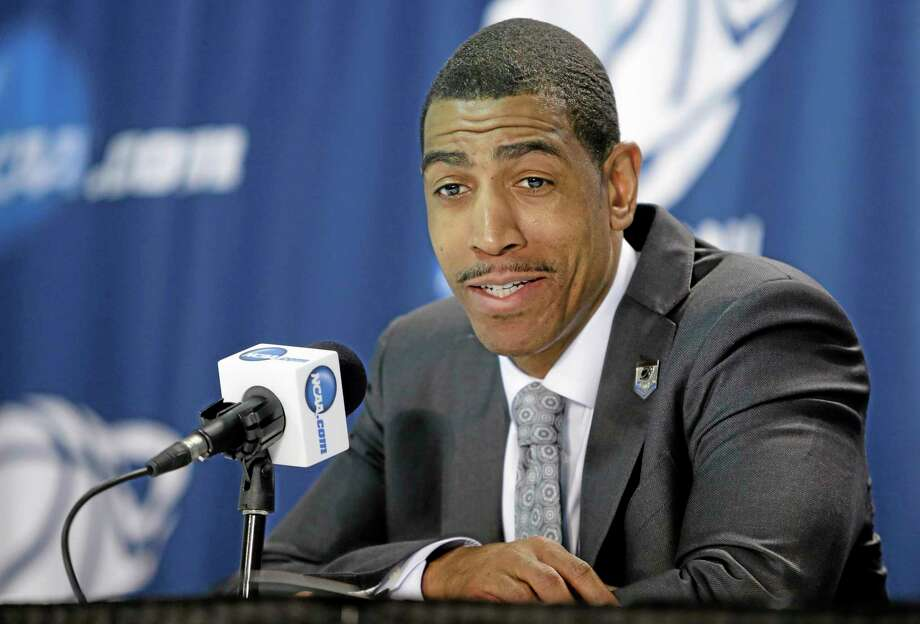 Connecticut head coach Kevin Ollie responds to questions during a news conference after a third-round game against Villanova in the NCAA men's college basketball tournament in Buffalo, N.Y., Sunday, March 23, 2014. Connecticut won the game 77-65. (AP Photo/Nick LoVerde) Photo: AP / FR1171125 AP