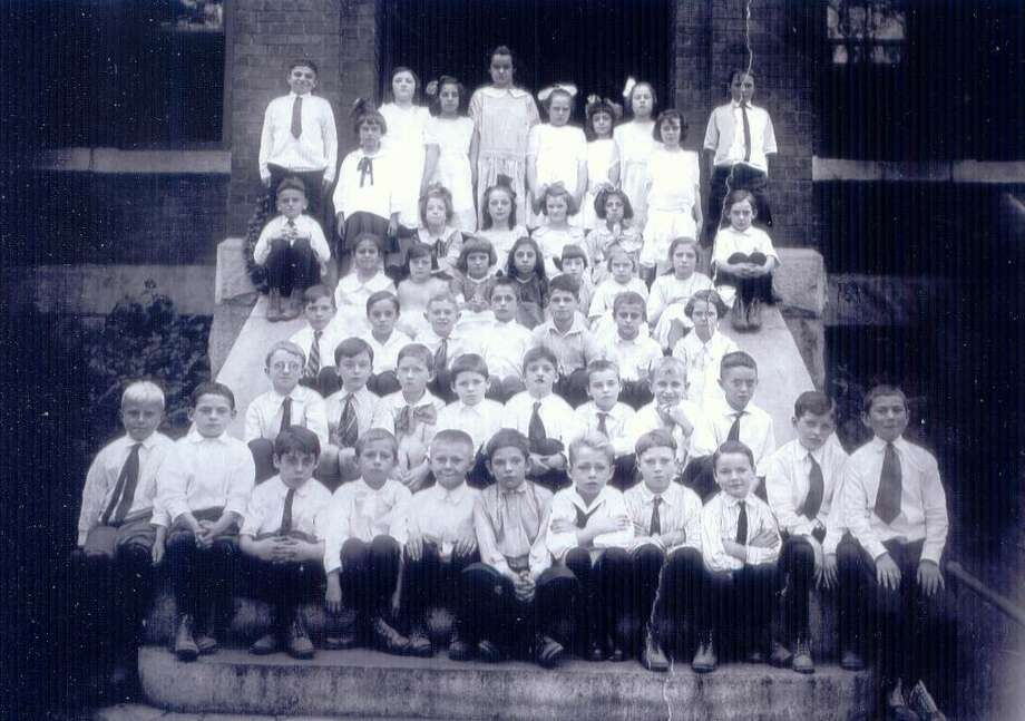 This photograph, from the collection of Bill McNamara of Danbury, shows the third-grade class of St. Peter School, Main Street, Danbury, in 1926. James McNamara, Bill's father, is in the front row, fourth from the right. Photo: Contributed Photo / The News-Times Contributed