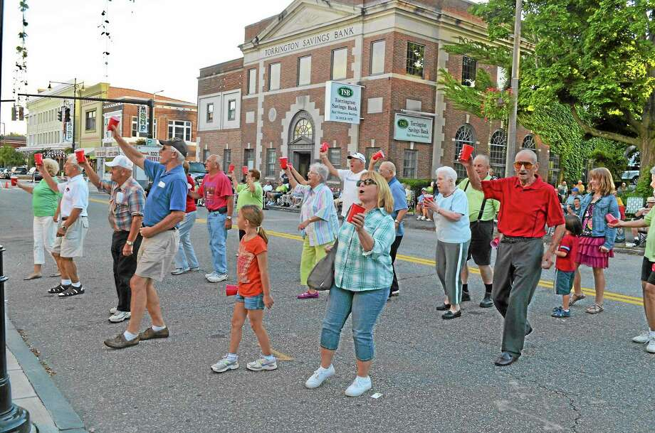 """Audience members dance to the Eddie Forman Orchestra's performance of """"Red Solo Cup"""" during the Mayor's Polka Party on Friday, August 23. A large crowd of people came out for the performance in front of City Hall, with many bringing their lawn chairs and enjoying popcorn. Photo: Esteban L. Hernandez - Register Citizen"""