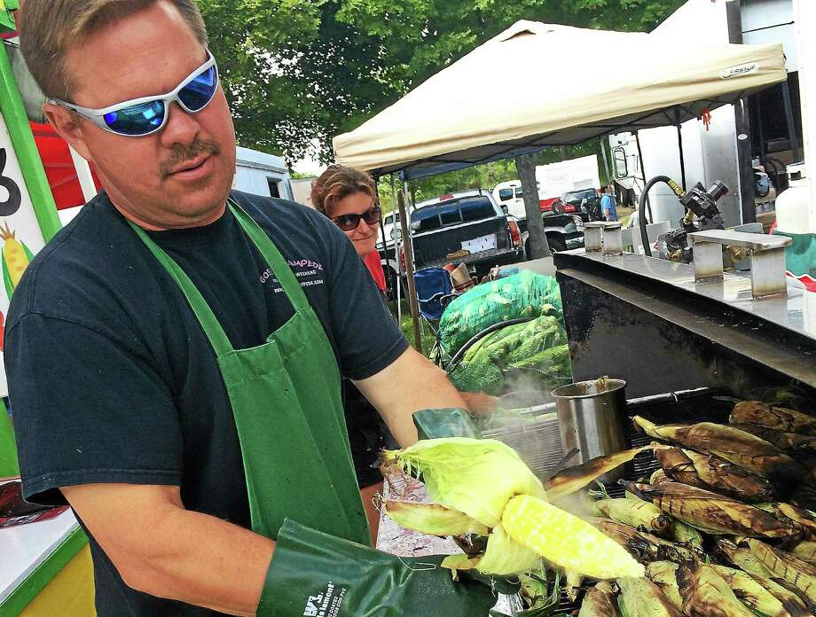 Sean O'Neill of Goshen makes fried, roasted corn at the Goshen Fair on Saturday. Photo: Daniela Forte — CORRESPONDENT
