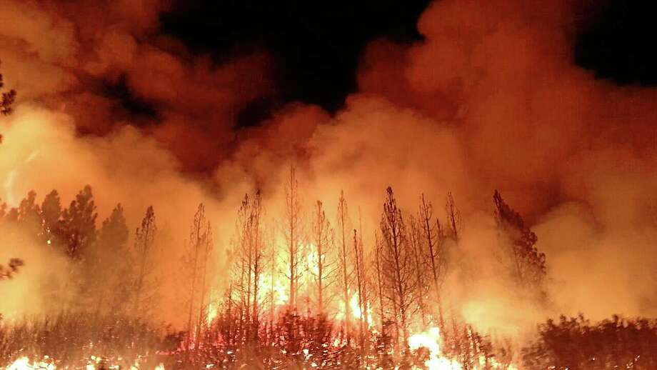 In this undated photo provided by the U.S. Forest Service, the Rim Fire burns near Yosemite National Park, Calif. The wildfire outside Yosemite National Park — one of more than 50 major brush blazes burning across the western U.S. — more than tripled in size overnight and still threatens about 2,500 homes, hotels and camp buildings. Fire officials said the blaze burning in remote, steep terrain had grown to more than 84 square miles and was only 2 percent contained on Thursday, down from 5 percent a day earlier. (AP Photo/U.S. Forest Service) Photo: AP / U.S. Forest Service