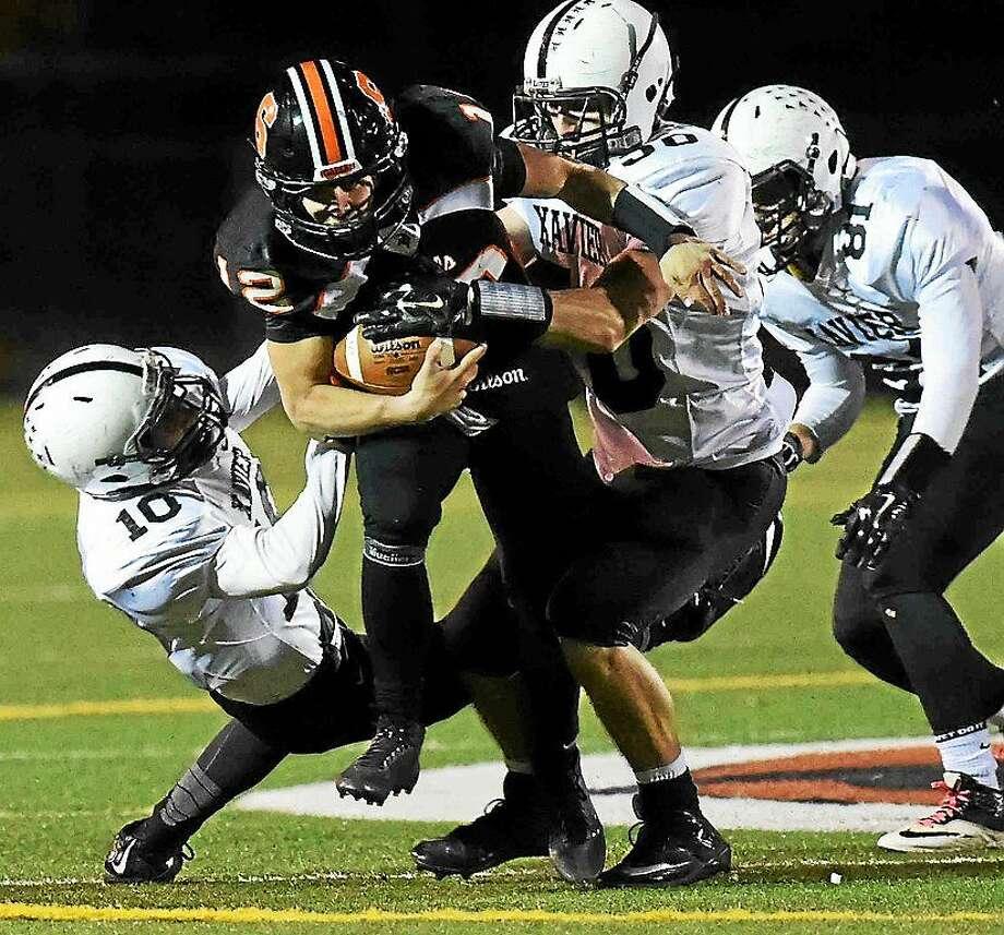 "Shelton quarterback Mark Piccirillo tries to gain yardage during Shelton's regular-season win over Xavier. Photo: ©2014 Peter Hvizdak / """""