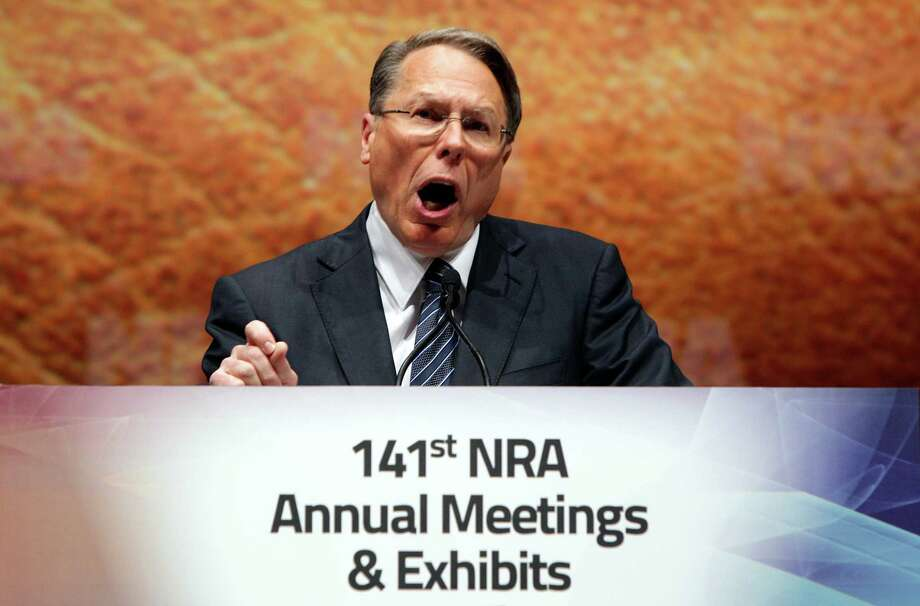 "Wayne LaPierre Jr., Executive Vice President and Chief Executive Officer of the National Rifle Association speaks at its members annual meeting during its national convention in St. Louis on Saturday, April 14, 2012. LaPierre levied sharp criticism against the national media on Saturday, accusing it of sensationalizing the Trayvon Martin case and ignoring other crimes that happen across the country every day. He didn't mention the Martin case by name, but he accused the media of ""sensational reporting from Florida."" The 17-year-old Martin was unarmed when he was fatally shot Feb. 26 in Sanford, Fla., by neighborhood watch volunteer George Zimmerman, who claimed self-defense. (AP Photo/St. Louis Post-Dispatch, Christian Gooden) Photo: AP / St. Louis Post-Dispatch"