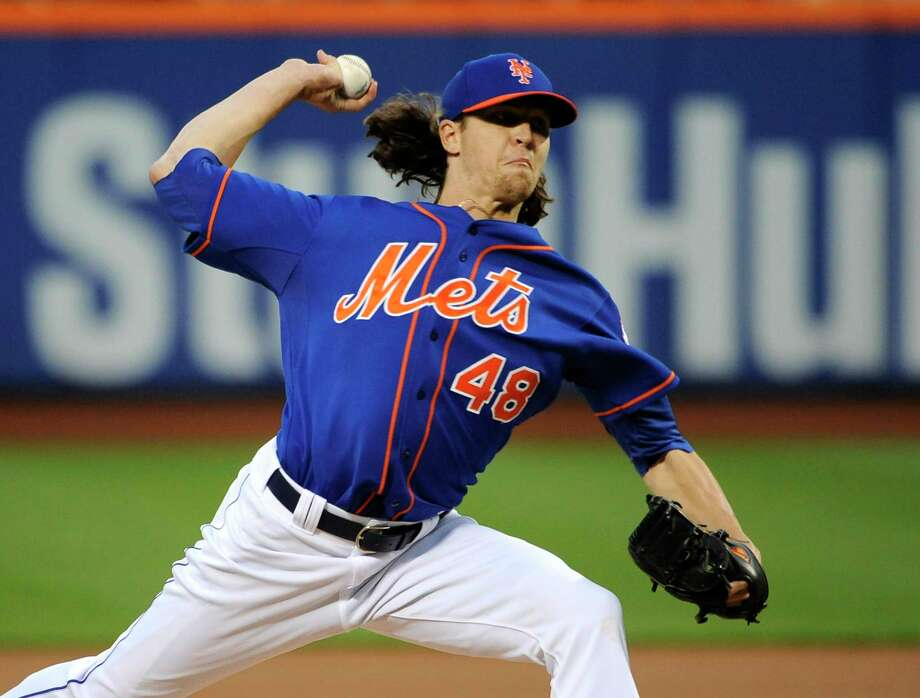Mets starter Jacob deGrom pitches against the Philadelphia Phillies in the first inning of New York's 4-1 win on Friday night at Citi Field in Queens. Photo: Kathy Kmonicek — The Associated Press  / FR170189 AP