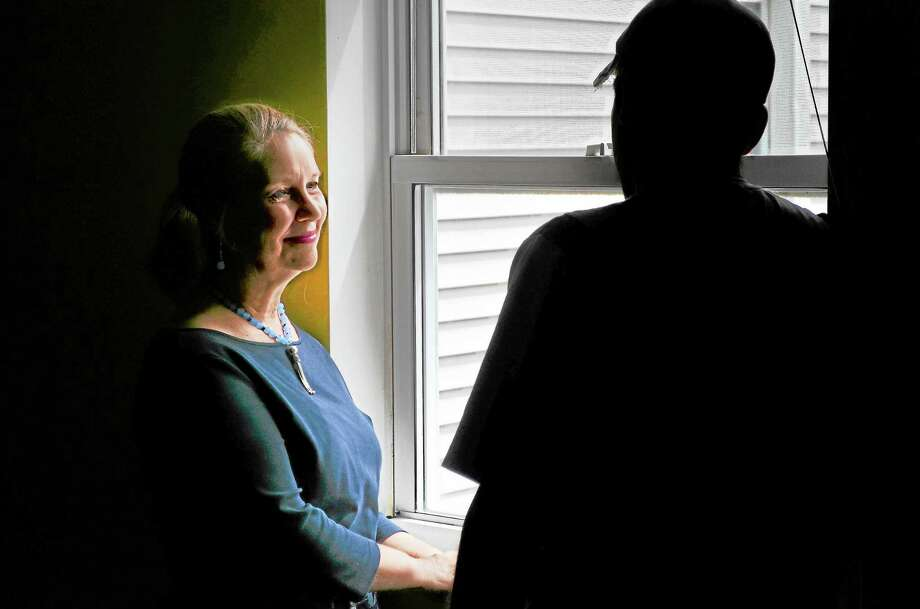 Deirdre DiCara of FISH in Torrington talks to one of the residents of a facility that FISH manages. He is recently homeless and has two young children and his family is getting assitance from FISH and state agencies to help find him a job which will allow him to get a place to live for his kids. Photo: John Berry — Register Citizen