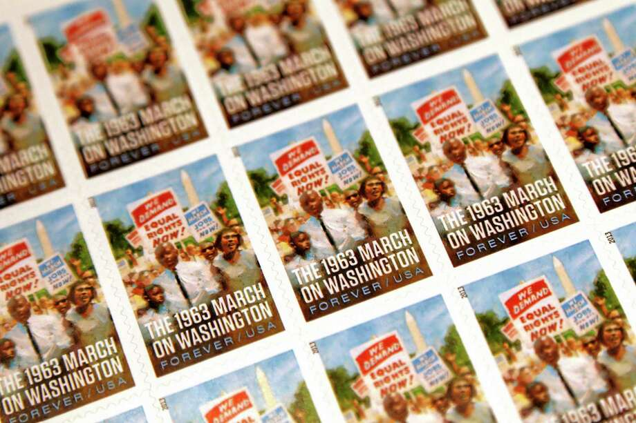 A sheet of the U.S. Postal Service stamp commemorating the 50th anniversary of the March on Washington is seen during an unveiling event at the Newseum in Washington, Friday, Aug. 23, 2013. Photo: Charles Dharapak — The Associated Press  / AP