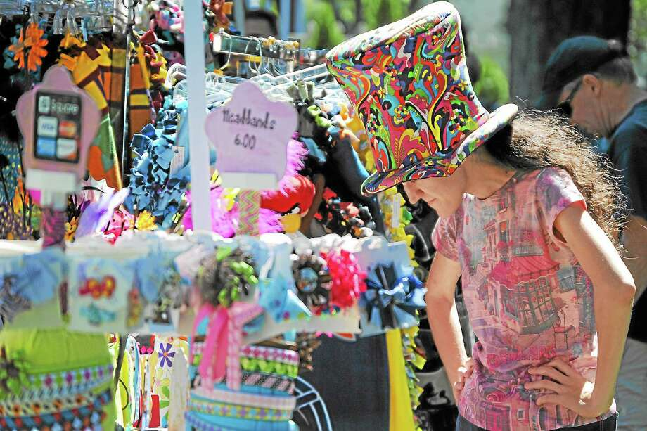 An attendee of North Congregational Church's 17th Annual Peach Fest and Craft Show looks at some of the crafts available. Photo: Journal Register Co.