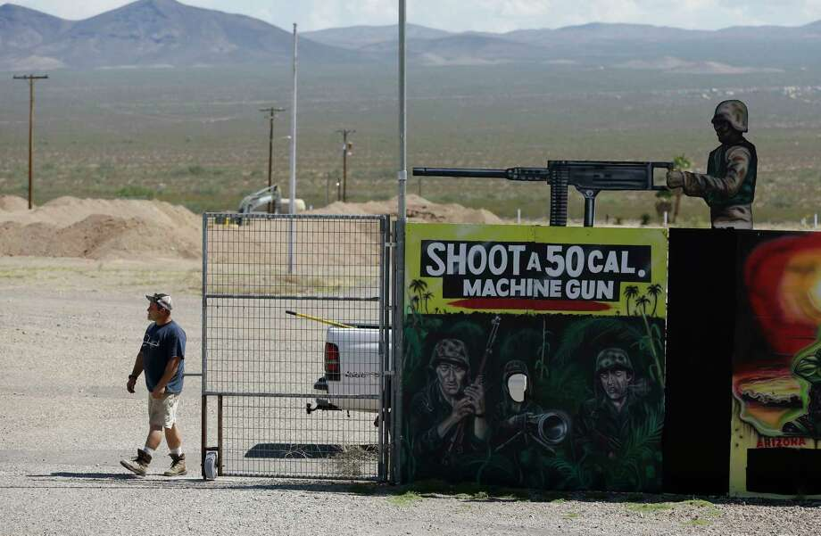 A man closes off an entrance to the Last Stop outdoor shooting range Wednesday, Aug. 27, 2014, in White Hills, Ariz. Gun range instructor Charles Vacca was accidentally killed Monday, Aug. 25, 2014 at the range by a 9-year-old with an Uzi submachine gun. Photo: (AP Photo/John Locher) / AP
