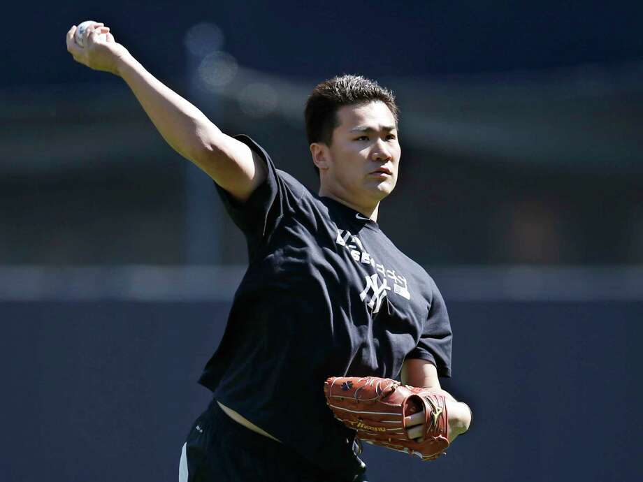 Yankees starter Masahiro Tanaka, who is on the disabled list, throws before a game against the Chicago White Sox in New York on Sunday. Photo: Kathy Willens — The Associated Press  / AP