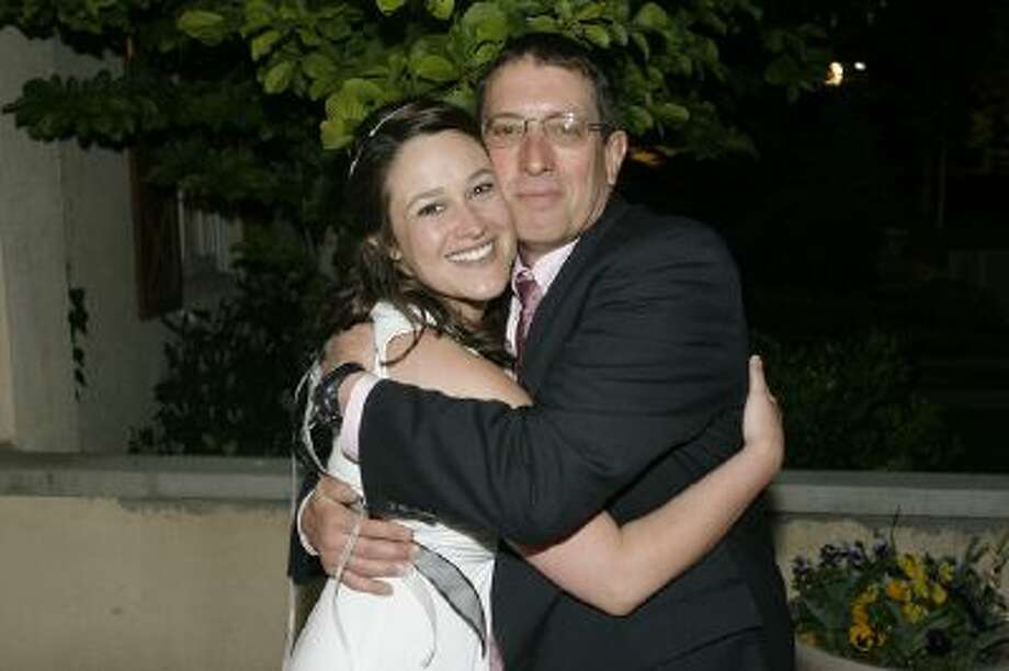 Barry Gomberg with daughter Marina at her 2009 commitment ceremony to Elenor Heyborne. The couple wed legally Friday. Courtesy Marina Gomberg